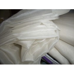 silk organza off white{light ivory} 110 inches wide{279 cms}.